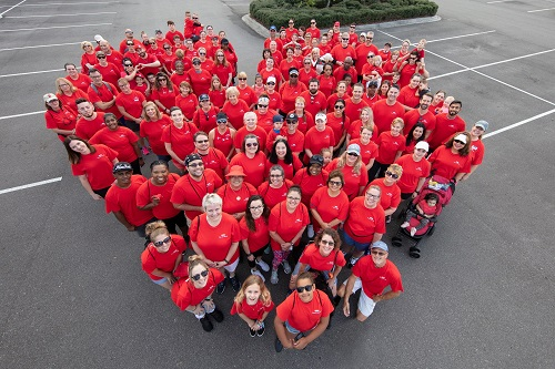 Health First Heart Walk Team wearing red shirts standing in the shape of a heart.