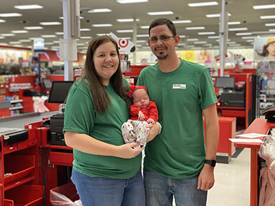 Rachel, husband and newborn in Target store