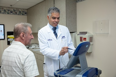 Dr. Ramirez reviewing records with patient