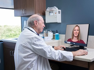 Health First Provider on Computer Virtual Visit with Patient